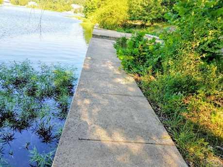 10212 Lake Ridge Dr #Joined Lot Concrete Seawall, Boat Slip - Photo 6