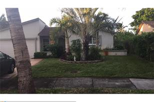 5841 NW 56th Pl - Photo 1