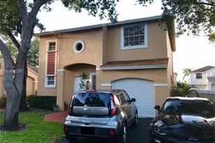 11834 NW 13th St - Photo 1