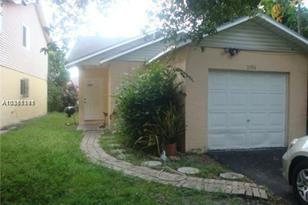 5396 NW 23rd St - Photo 1