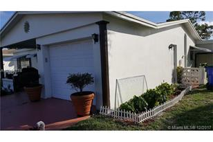 7190 NW 10th Ct - Photo 1