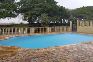 4275 NW South Tamiami Canal Dr #2-103 - Photo 1