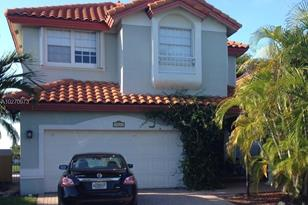 10441 NW 56th Ter - Photo 1