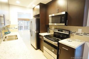 1801 NW 58th Ave #14 - Photo 1
